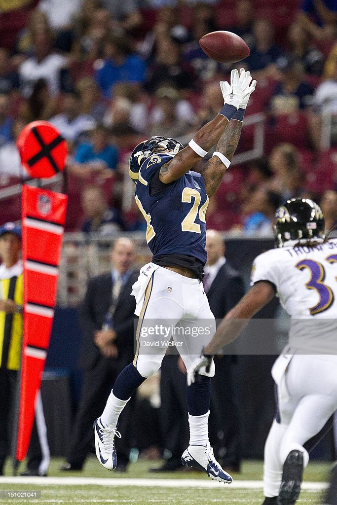 Running back <a gi-track='captionPersonalityLinkClicked' href=/galleries/search?phrase=Isaiah+Pead&family=editorial&specificpeople=6237657 ng-click='$event.stopPropagation()'>Isaiah Pead</a> #24 of the St. Louis Rams leaps to catch a pass during the game against the Baltimore Ravens at the Edward Jones Dome on August 30, 2012 in St. Louis, Missouri. The St. Louis Rams defeated the Baltimore Ravens 31-17.