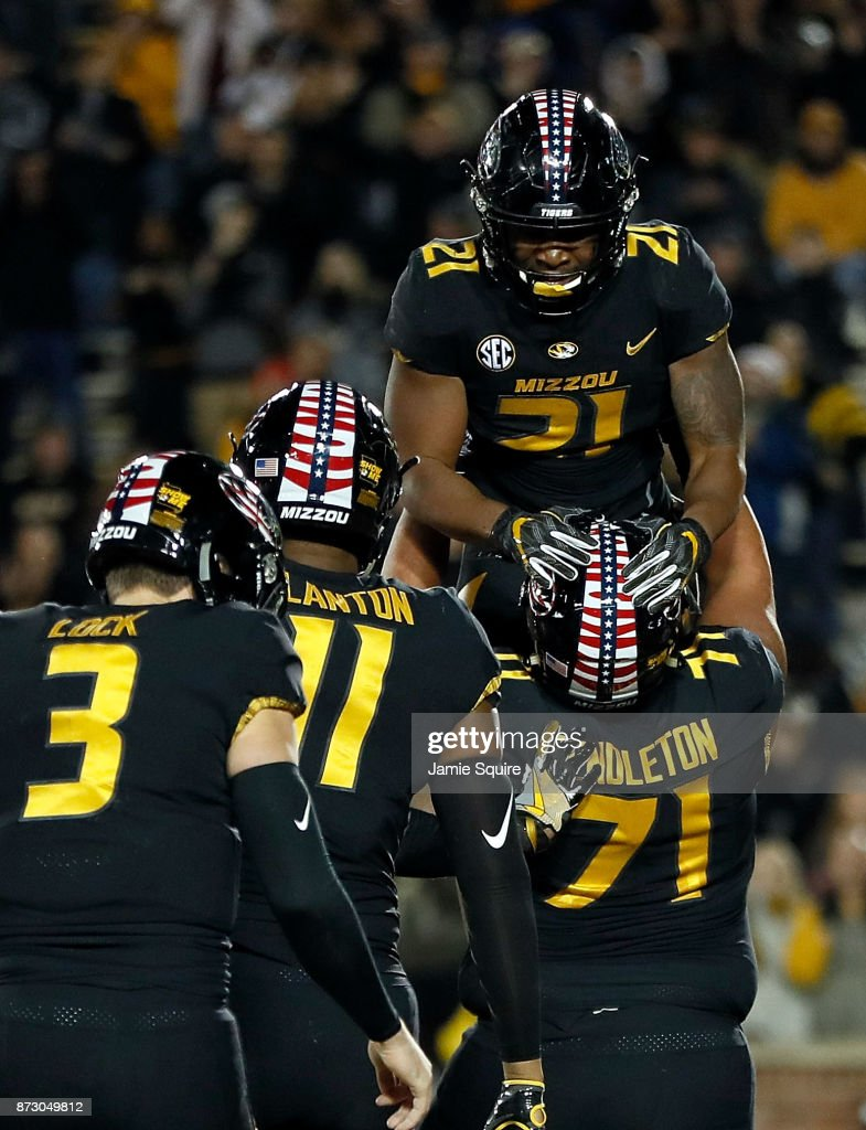 Running back Ish Witter #21 of the Missouri Tigers is lifted by offensive lineman Kevin Pendleton #71 after scoring a touchdown during the game against the Tennessee Volunteers at Faurot Field/Memorial Stadium on November 11, 2017 in Columbia, Missouri.