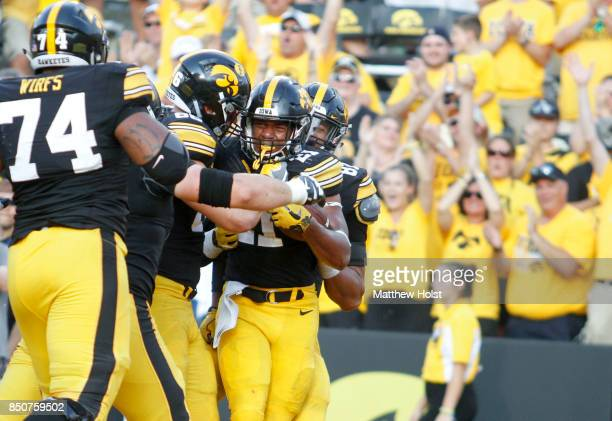 Running back Ivory KellyMartin of the Iowa Hawkeyes celebrates a touchdown during the fourth quarter against the North Texas Mean Green on September...