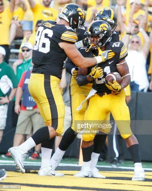 Running back Ivory KellyMartin of the Iowa Hawkeyes celebrates a touchdown with tight end Peter Pekar during the fourth quarter against the North...