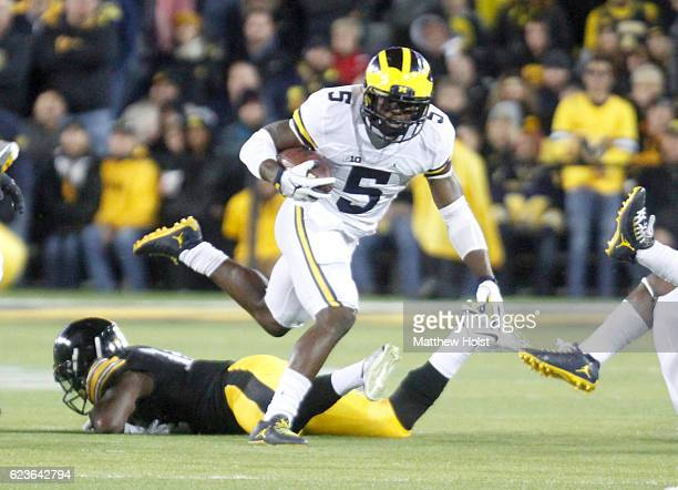 Running back Jabrill Peppers of the Michigan Wolverines breaks a tackle during the second quarter by defensive back Desmond King of the Iowa Hawkeyes...