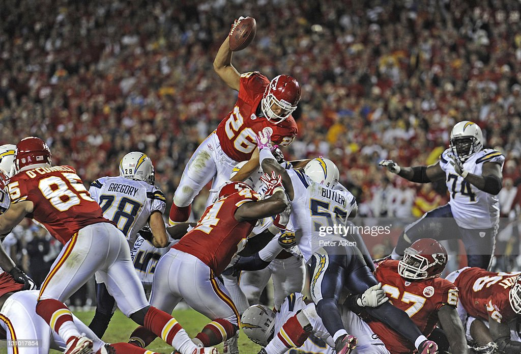 Running back <a gi-track='captionPersonalityLinkClicked' href=/galleries/search?phrase=Jackie+Battle&family=editorial&specificpeople=2852926 ng-click='$event.stopPropagation()'>Jackie Battle</a> #26 of the Kansas City Chiefs dives over the San Diego Chargers defense from one-yard out for a touchdown during the fourth quarter on October 31, 2011 at Arrowhead Stadium in Kansas City, Missouri. The Chiefs defeated the Chargers 23-20 in overtime.