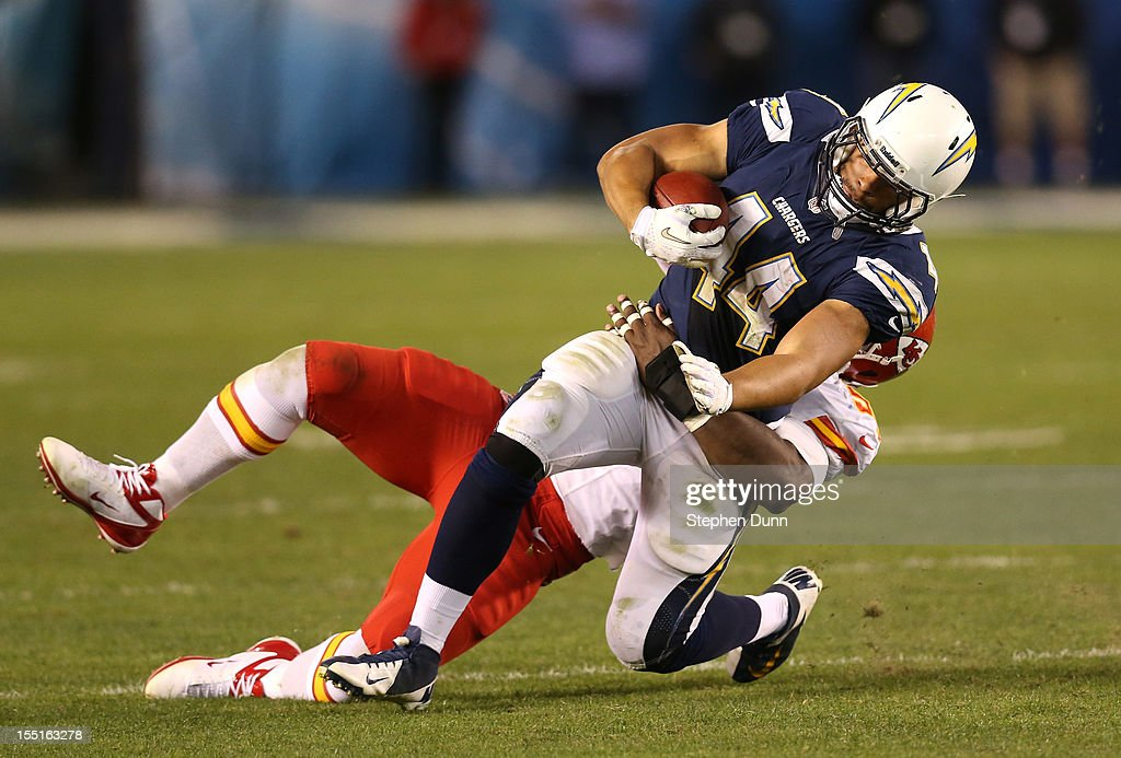 Running back <a gi-track='captionPersonalityLinkClicked' href=/galleries/search?phrase=Jackie+Battle&family=editorial&specificpeople=2852926 ng-click='$event.stopPropagation()'>Jackie Battle</a> #44 of the San Diego Chargers is brought down at the end of a run by linebacker Justin Houston #50 of the Kansas City Chiefs at Qualcomm Stadium on November 1, 2012 in San Diego, California. The Chargers won 31-13.