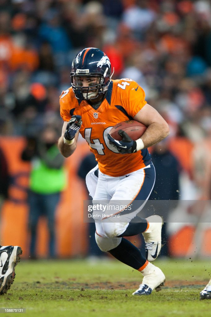 Running back <a gi-track='captionPersonalityLinkClicked' href=/galleries/search?phrase=Jacob+Hester&family=editorial&specificpeople=2109848 ng-click='$event.stopPropagation()'>Jacob Hester</a> #40 of the Denver Broncos rushes against the Kansas City Chiefs during a game at Sports Authority Field at Mile High on December 30, 2012 in Denver, Colorado. The Broncos defeated the Chiefs 38-3.