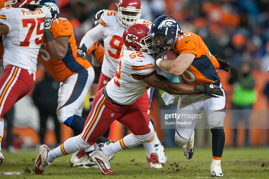 Running back Jacob Hester #40 of the Denver Broncos rushes as inside linebacker Brandon Siler #52 of the Kansas City Chiefs attempts to tackle him during a game at Sports Authority Field Field at Mile High on December 30, 2012 in Denver, Colorado. The Broncos defeated the Chiefs 38-3.