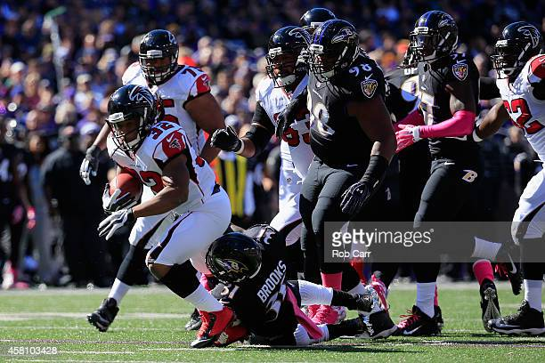Running back Jacquizz Rodgers of the Atlanta Falcons is tackled by free safety Terrence Brooks of the Baltimore Ravens at MT Bank Stadium on October...