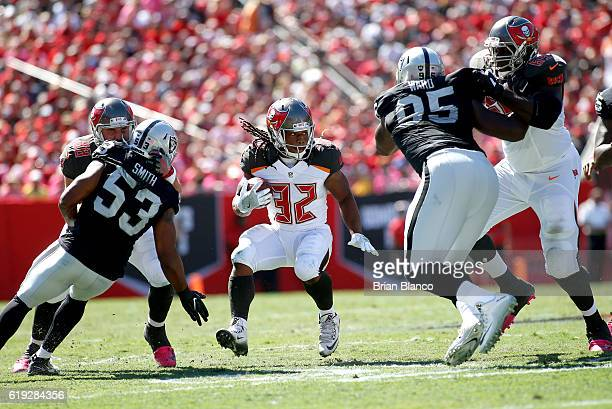 Running back Jacquizz Rodgers of the Tampa Bay Buccaneers gets some help from tight end Luke Stocker and tackle Demar Dotson as he finds room to run...
