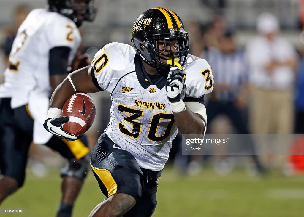 Running back Jalen Richard #30 of the Southern Mississippi Golden Eagles runs the ball against the Central Florida Knights during the game at Bright House Networks Stadium on October 13, 2012 in Orlando, Florida.