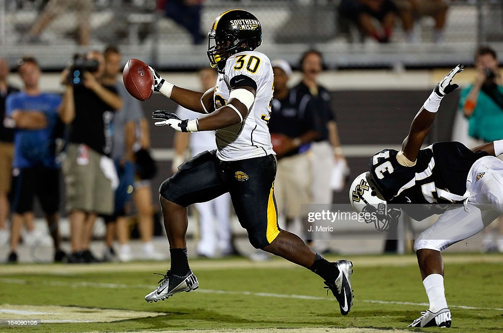 Running back Jalen Richard #30 of the Southern Mississippi Golden Eagles scores a touchdown against the Central Florida Knights during the game at Bright House Networks Stadium on October 13, 2012 in Orlando, Florida.
