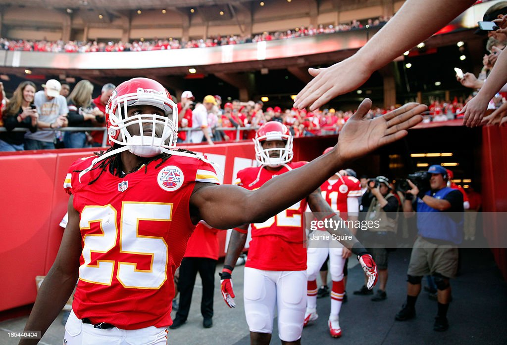 Running back <a gi-track='captionPersonalityLinkClicked' href=/galleries/search?phrase=Jamaal+Charles&family=editorial&specificpeople=2122501 ng-click='$event.stopPropagation()'>Jamaal Charles</a> #25 of the Kansas City Chiefs high-fives fans prior to the game against the Houston Texans at Arrowhead Stadium on October 20, 2013 in Kansas City, Missouri.