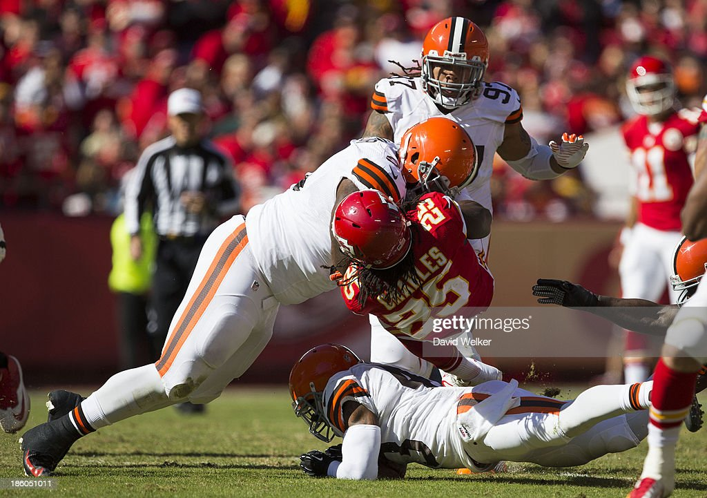 Running back <a gi-track='captionPersonalityLinkClicked' href=/galleries/search?phrase=Jamaal+Charles&family=editorial&specificpeople=2122501 ng-click='$event.stopPropagation()'>Jamaal Charles</a> #25 of the Kansas City Chiefs is hit by defensive tackle John Hughes #93 of the Cleveland Browns during the game at Arrowhead Stadium on October 27, 2013 in Kansas City, Missouri.