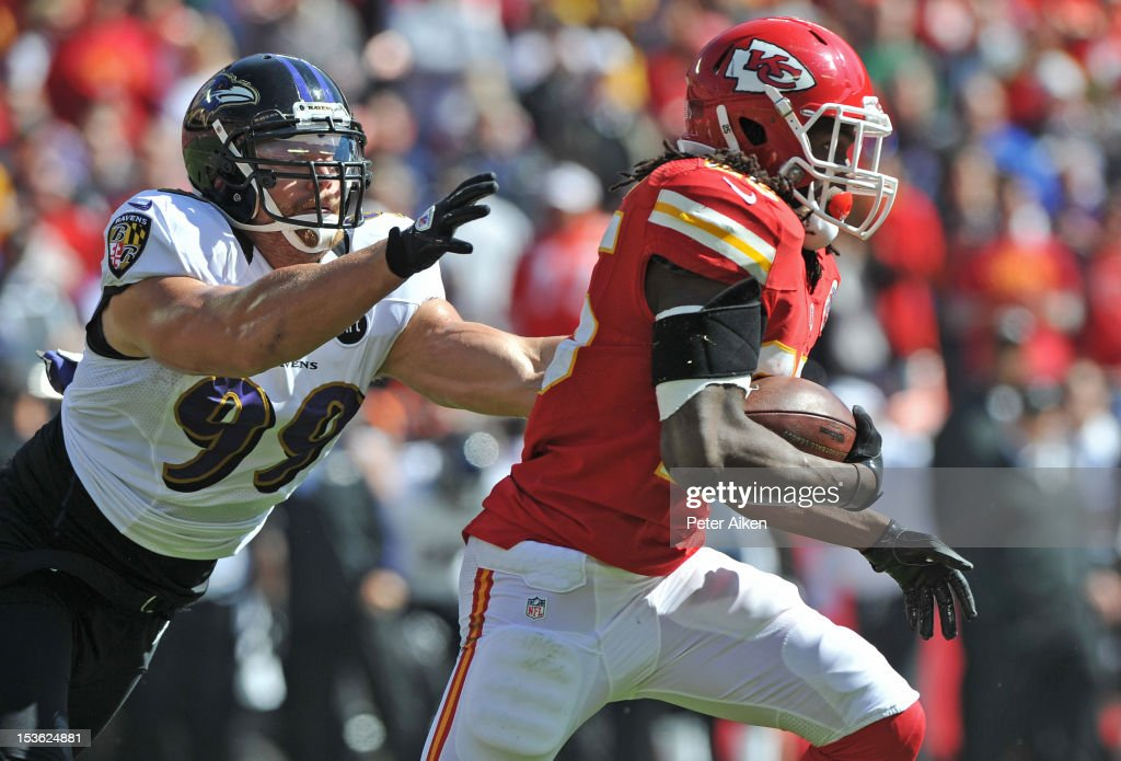 Running back Jamaal Charles #25 of the Kansas City Chiefs rushes past linebacker Paul Kruger #99 of the Baltimore Ravens during the first quarter on October 7, 2012 at Arrowhead Stadium in Kansas City, Missouri. Baltimore defeated Kansas City 9-6.