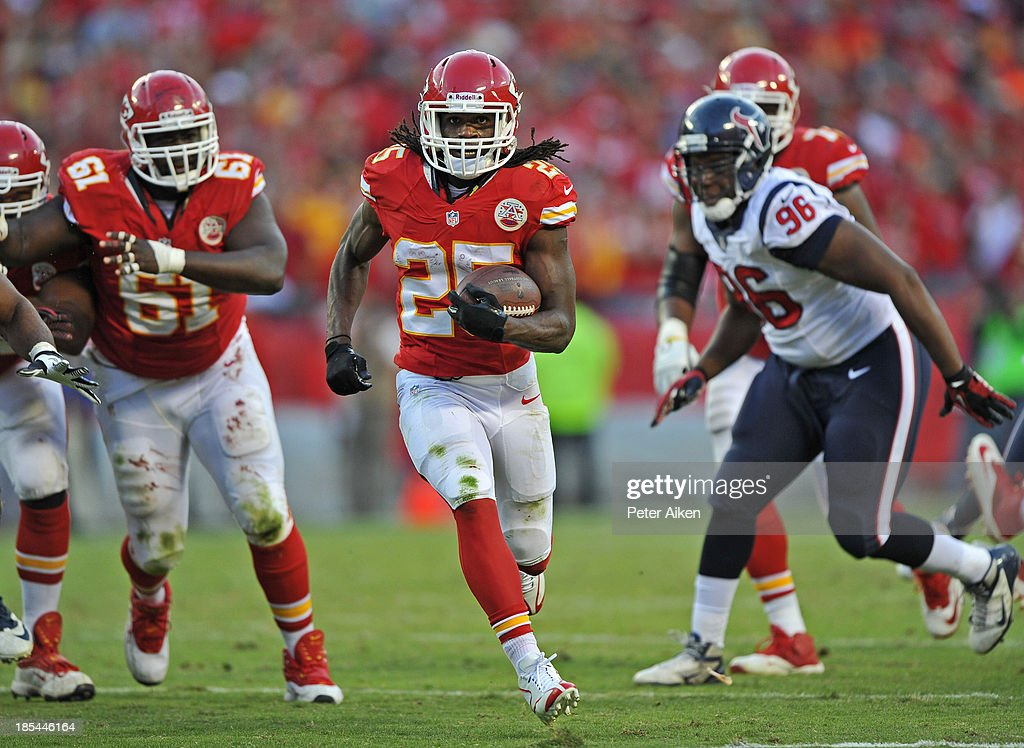 Running back Jamaal Charles #25 of the Kansas City Chiefs rushes past defensive end Tim Jamison #96 of the Houston Texans for a first down during the second half on October 20, 2013 at Arrowhead Stadium in Kansas City, Missouri. Kansas City won 17-16.