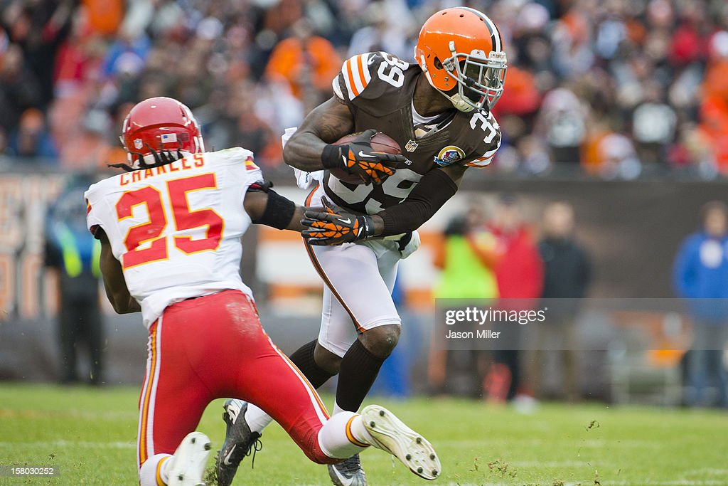 Running back <a gi-track='captionPersonalityLinkClicked' href=/galleries/search?phrase=Jamaal+Charles&family=editorial&specificpeople=2122501 ng-click='$event.stopPropagation()'>Jamaal Charles</a> #25 of the Kansas City Chiefs tries to stop free safety Tashaun Gipson #39 of the Cleveland Browns after Gipson caught an interception during the first half at Cleveland Browns Stadium on December 9, 2012 in Cleveland, Ohio.