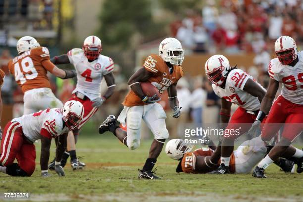 Running back Jamaal Charles of the Texas Longhorns sprints to a 40yard touchdown through a gap in the Nebraska Cornhuskers defense at Darrell K...