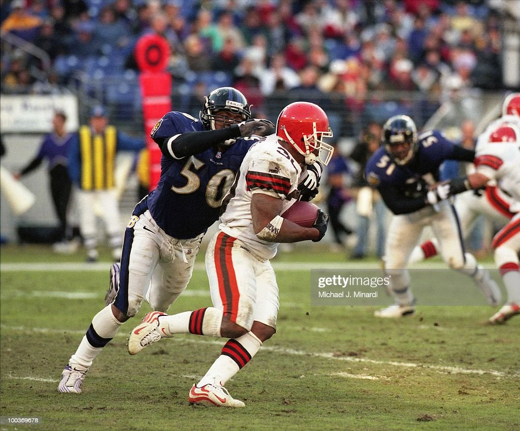 Running Back Jamel White #30 of the Cleveland Browns runs for yardage until he was tackled by Linebacker Brad Jackson #50 of the Baltimore Ravens at PSINet Ravens Stadium on November 26, 2000 in Baltimore, Maryland. The Ravens won 44 to 7.