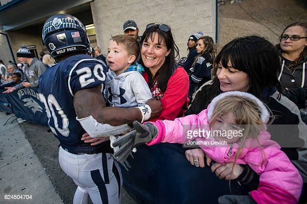 Running back James Butler of the Nevada Wolf Pack celebrates with fans after the win over the Utah State Aggies at Mackay Stadium on November 19 2016...