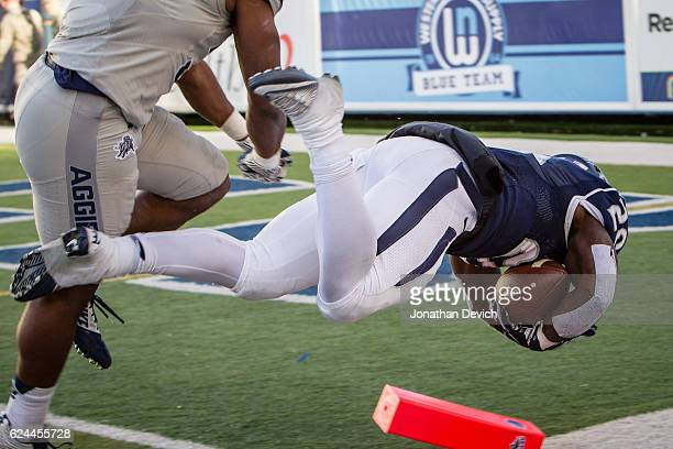 Running back James Butler of the Nevada Wolf Pack falls into the end zone for a touchdown against the Utah State Aggies at Mackay Stadium on November...