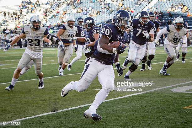 Running back James Butler of the Nevada Wolf Pack runs for a touchdown against the Utah State Aggies at Mackay Stadium on November 19 2016 in Reno...