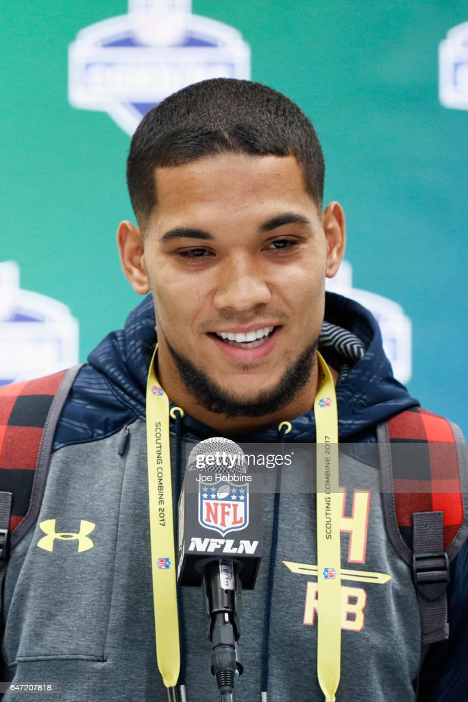 Running back James Conner of Pittsburgh answers questions from the media on Day 2 of the NFL Combine at the Indiana Convention Center on March 2, 2017 in Indianapolis, Indiana.