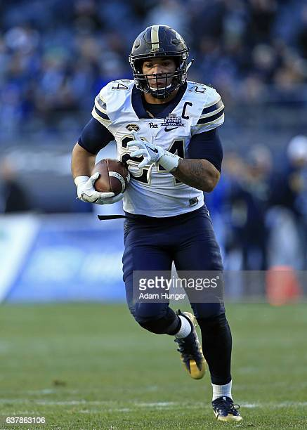 Running back James Conner of the Pittsburgh Panthers in action against the Northwestern Wildcats during the New Era Pinstripe Bowl at Yankee Stadium...