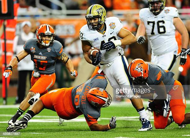 Running back James Conner of the Pittsburgh Panthers runs the football runs the football during a game against the Bowling Green Falcons during the...