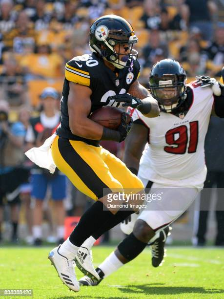 Running back James Conner of the Pittsburgh Steelers carries the ball in the second quarter of a preseason game on August 20 2017 against the Atlanta...