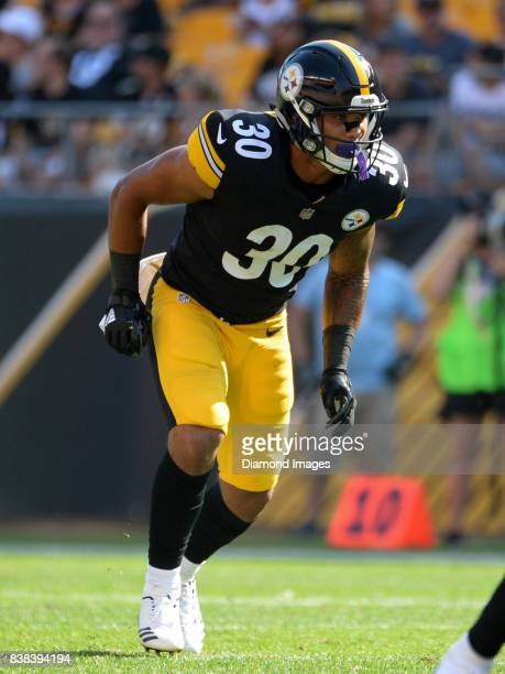 Running back James Conner of the Pittsburgh Steelers runs at the start of a play in the second quarter of a preseason game on August 20 2017 against...