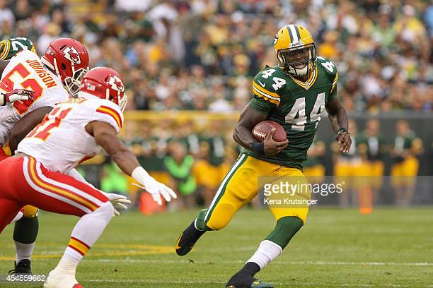 Running back James Starks of the Green Bay Packers carries the ball up the field in the first quarter of the preseason game against the Kansas City...