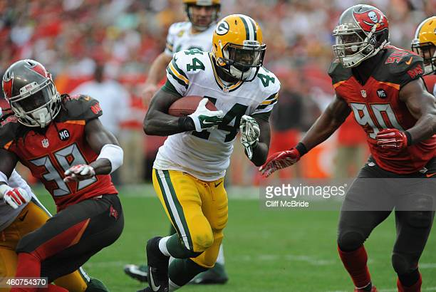 Running back James Starks of the Green Bay Packers carries the ball in the fourth quarter against the Tampa Bay Buccaneers at Raymond James Stadium...