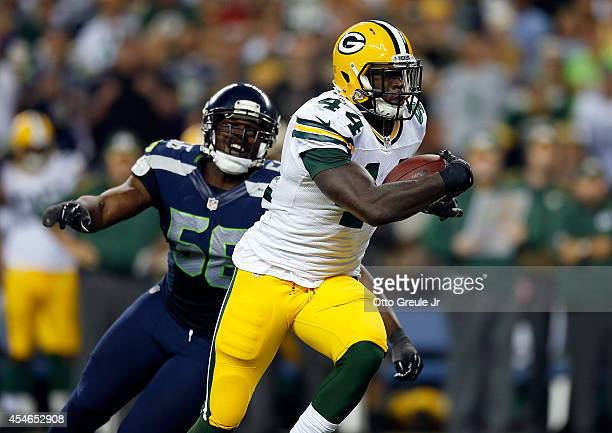 Running back James Starks of the Green Bay Packers gets past defensive end Cliff Avril of the Seattle Seahawks during the third quarter of the game...