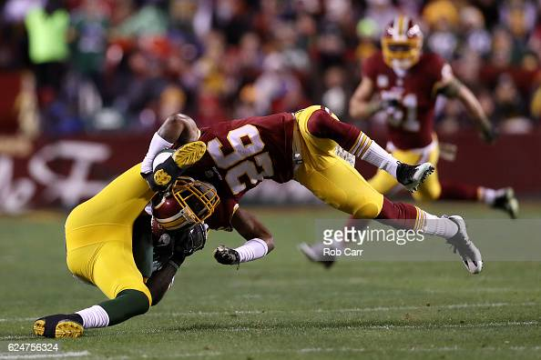 Running back James Starks of the Green Bay Packers is tackled by cornerback Bashaud Breeland of the Washington Redskins in the first quarter at...
