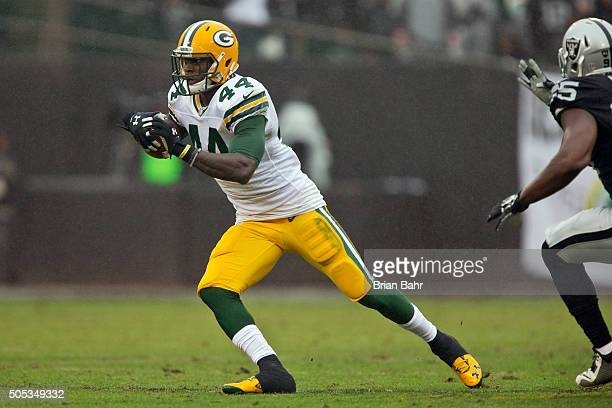 Running back James Starks of the Green Bay Packers makes a catch for five yards against the Oakland Raiders late in the second quarter on December 20...