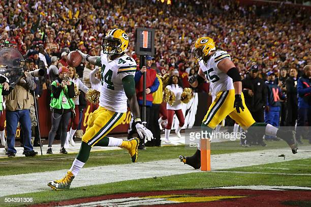Running back James Starks of the Green Bay Packers scores a third quarter touchdown against the Washington Redskins during the NFC Wild Card Playoff...