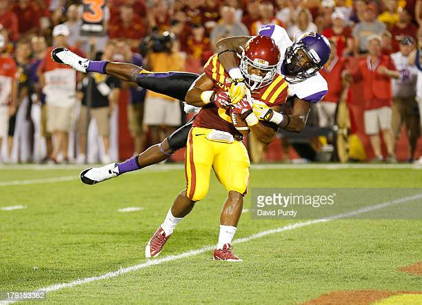 Running back James White of the Iowa State Cyclones carries defensive back Deiondre' Hall of the Northern Iowa Panthers across the goal line as he...