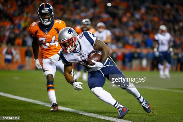 Running back James White of the New England Patriots has a fourth quarter touchdown catch against the Denver Broncos at Sports Authority Field at...