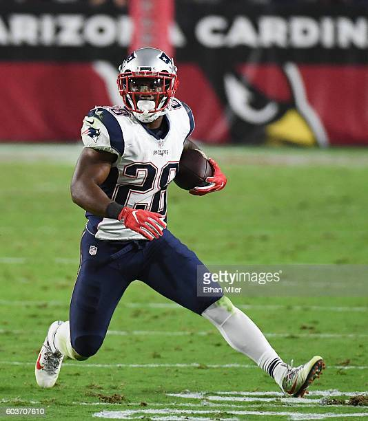 Running back James White of the New England Patriots runs for yardage against the Arizona Cardinals during the NFL game at University of Phoenix...