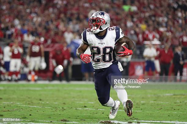 Running back James White of the New England Patriots runs with the football against the Arizona Cardinals during the NFL game at the University of...