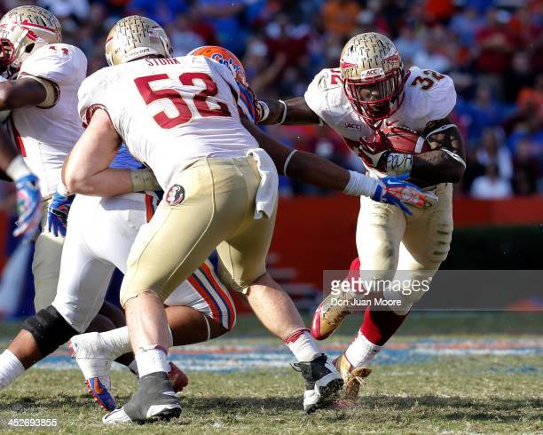 Running back James Wilder Jr #32 of the Florida State Seminoles on a running play during the game against the Florida Gators at Ben Hill Griffin...