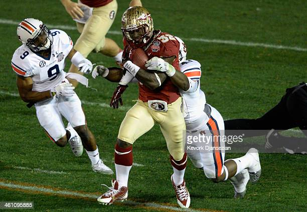 Running back James Wilder Jr #32 of the Florida State Seminoles runs with the ball against the Auburn Tigers during the 2014 Vizio BCS National...