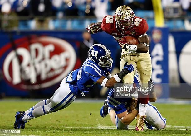 Running back James Wilder Jr #32 of the Florida State Seminoles carries the ball as cornerback Deondre Singleton of the Duke Blue Devils defends...