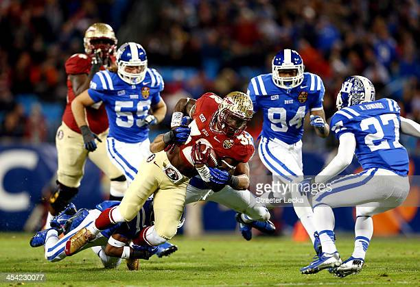 Running back James Wilder Jr #32 of the Florida State Seminoles carries the ball as Deondre Singleton of the Duke Blue Devils defends during the ACC...