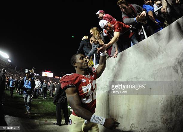 Running back James Wilder Jr #32 of the Florida State Seminoles walks off the field following their 3431 win over the Auburn Tigers in the 2014 Vizio...