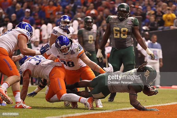 Running back JaMycal Hasty of the Baylor Bears dives into the end zone to score on a five yard touchdown rush against the Boise State Broncos during...