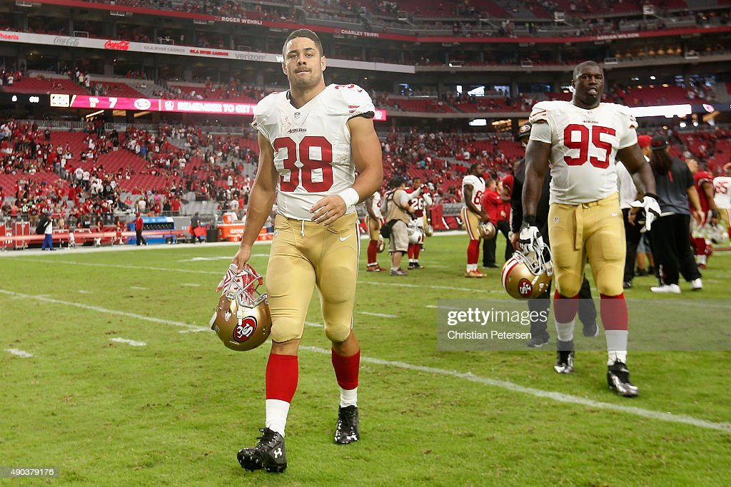 Running back <a gi-track='captionPersonalityLinkClicked' href=/galleries/search?phrase=Jarryd+Hayne&family=editorial&specificpeople=563352 ng-click='$event.stopPropagation()'>Jarryd Hayne</a> #38 and defensive tackle <a gi-track='captionPersonalityLinkClicked' href=/galleries/search?phrase=Tank+Carradine&family=editorial&specificpeople=10915724 ng-click='$event.stopPropagation()'>Tank Carradine</a> #95 of the San Francisco 49ers walk off the field after being defeated by the Arizona Cardinals 47-7 in the NFL game at the University of Phoenix Stadium on September 27, 2015 in Glendale, Arizona.