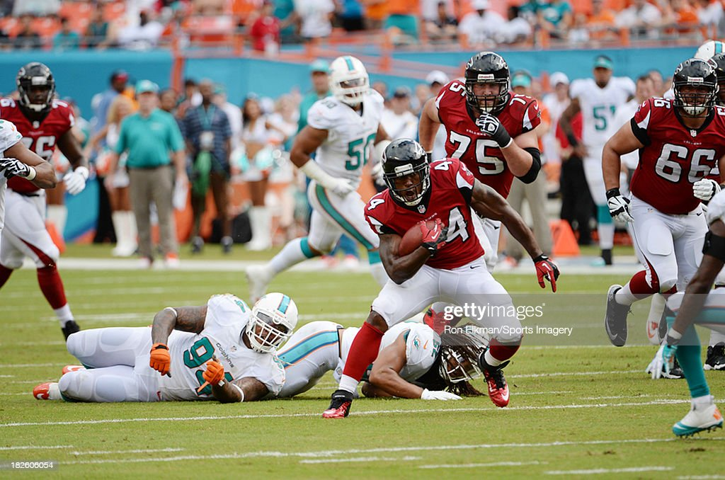 Running back Jason Snelling of the Atlanta Falcons carries the ball during a NFL game against the Miami Dolphins at Sun Life Stadium on September 22...