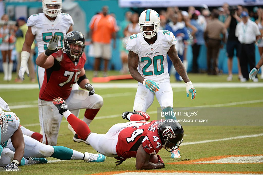Running back Jason Snelling of the Atlanta Falcons scores a touchdown during a NFL game against the Miami Dolphins at Sun Life Stadium on September...
