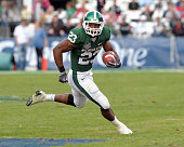 Running back Javon Ringer of the Michigan State Spartans rushes upfield against the Georgia Bulldogs during the 2009 Capital One Bowl at the Citrus...