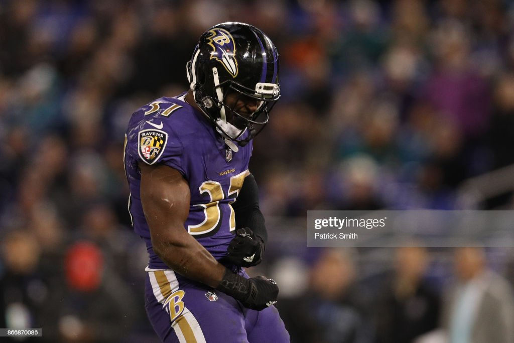 Running Back Javorius Allen #37 of the Baltimore Ravens celebrates after a play in the fourth quarter against the Miami Dolphins at M&T Bank Stadium on October 26, 2017 in Baltimore, Maryland.