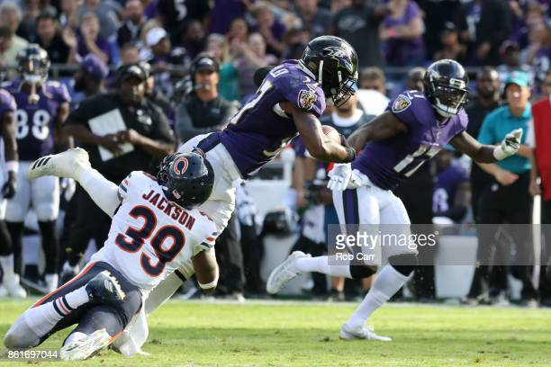 Running back Javorius Allen of the Baltimore Ravens is tackled by free safety Eddie Jackson of the Chicago Bears in the fourth quarter at MT Bank...